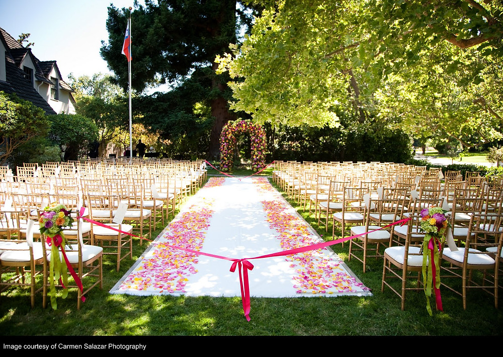 Arched floral chuppah, chair flowers and aisle petals by Visual Impact Design | Carmen Salazar Photography