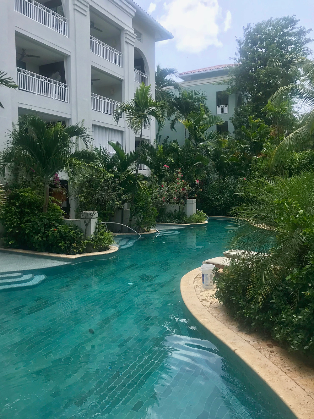 Walk out of your suite into the lazy river pool Sandals Royal Barbados
