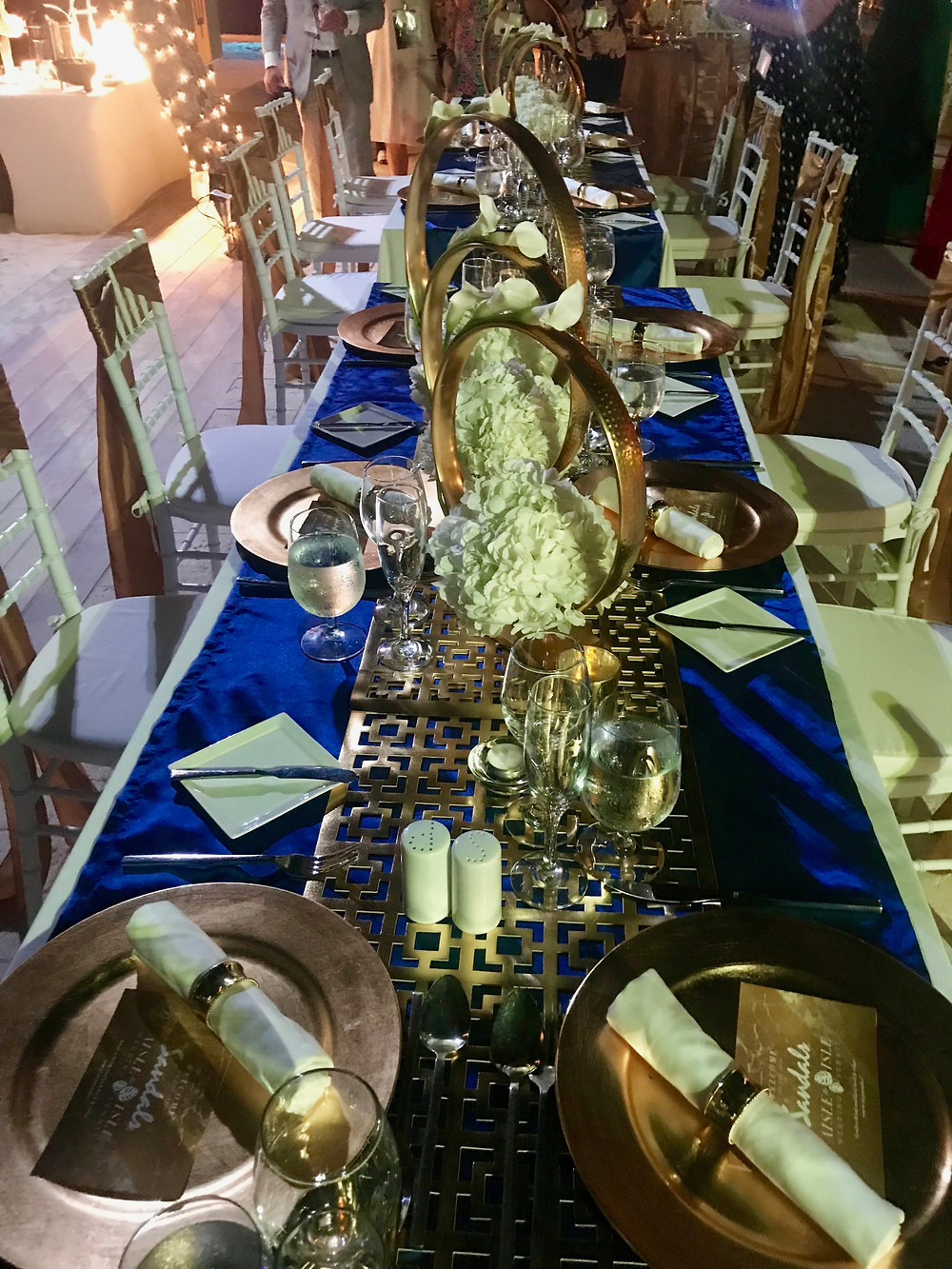 Outdoor wedding dinner reception at Sandals Royal Barbados - table centerpieces