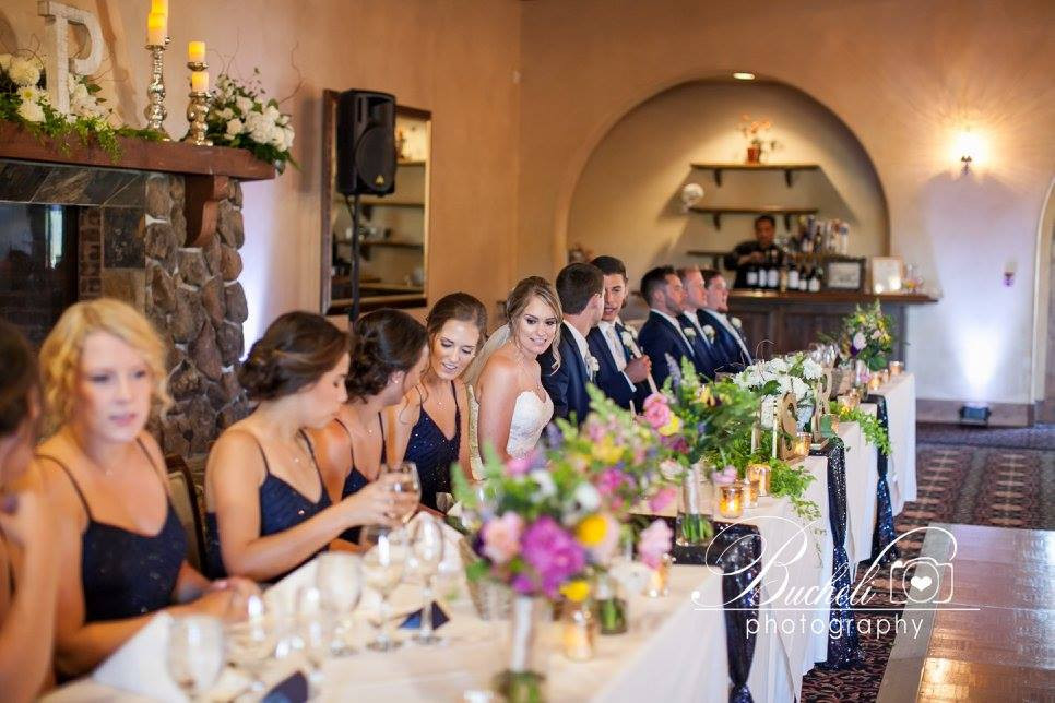 Bouquets, centerpieces and mantel flowers by Visual Impact Design | Bucheli Photography