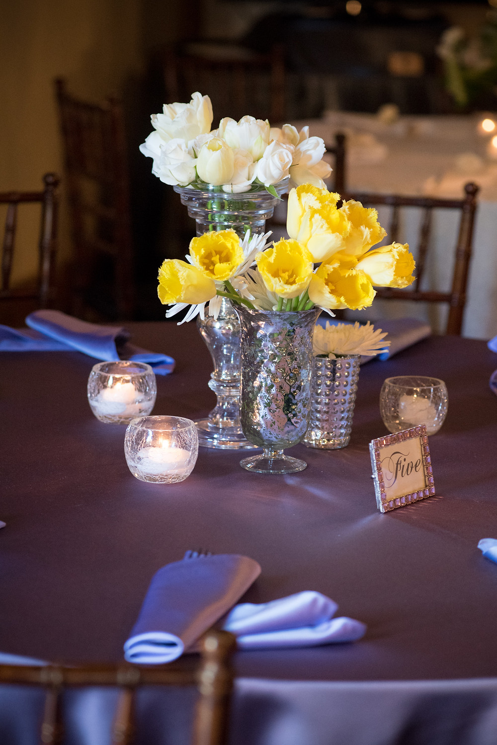 Yellow tulips and white rose centerpiece  by Visual Impact Design | Photo by Allison Stahl Studio