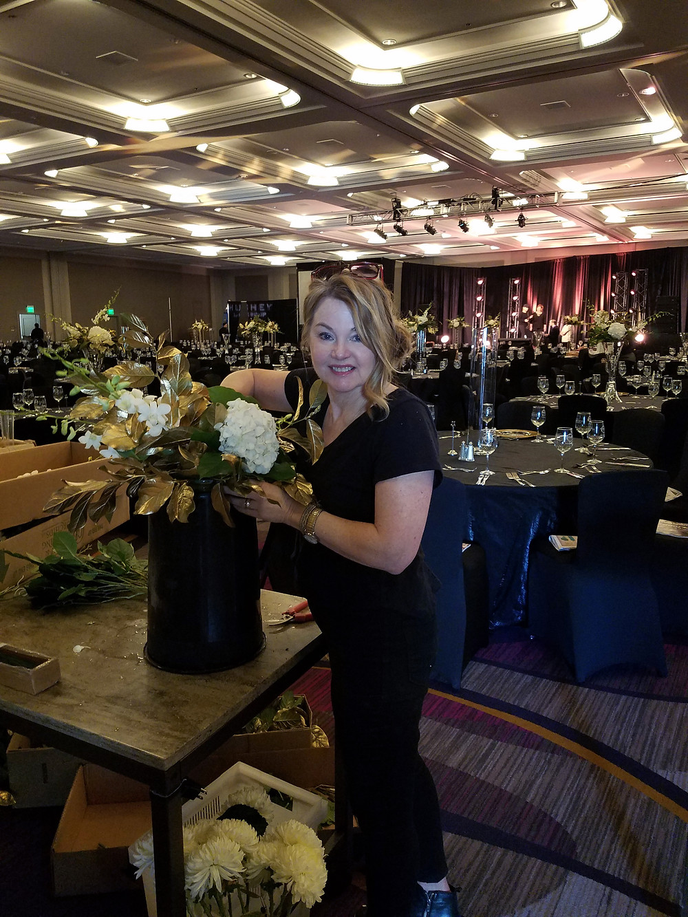 Cathy Brooks setting up florals for Make-A-Wish Foundation