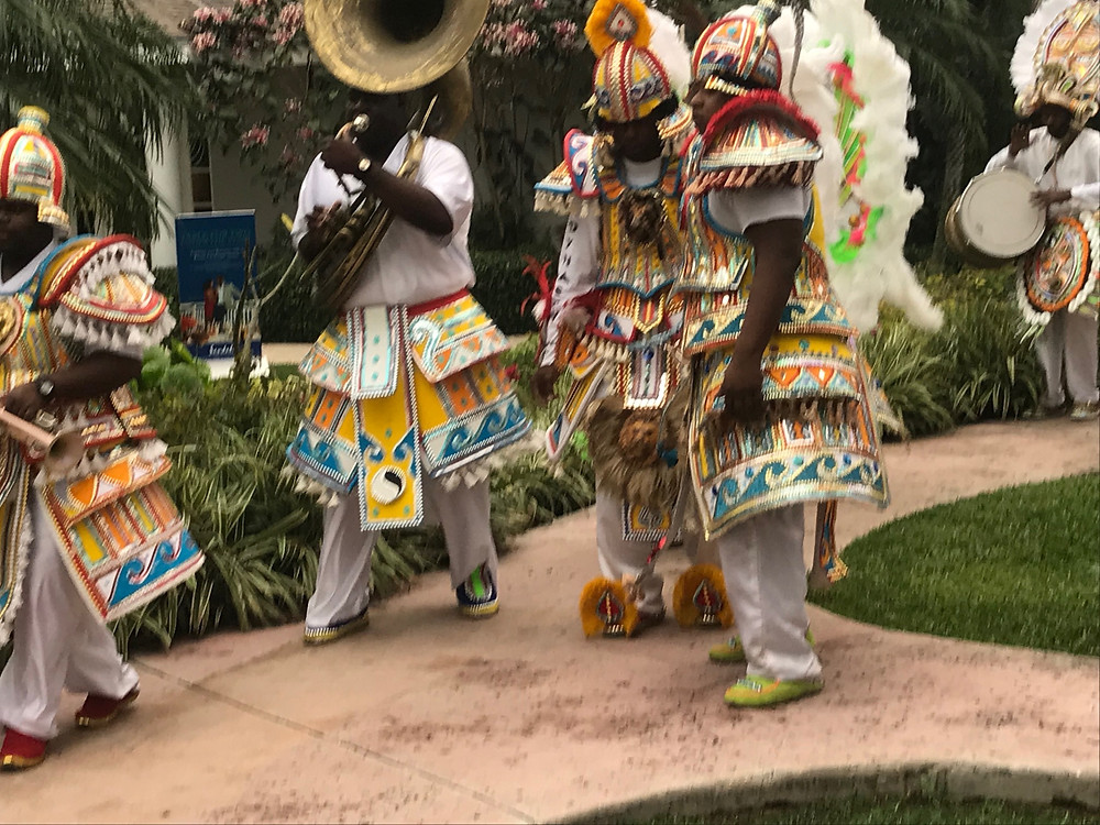 Festive musicians marching through resort