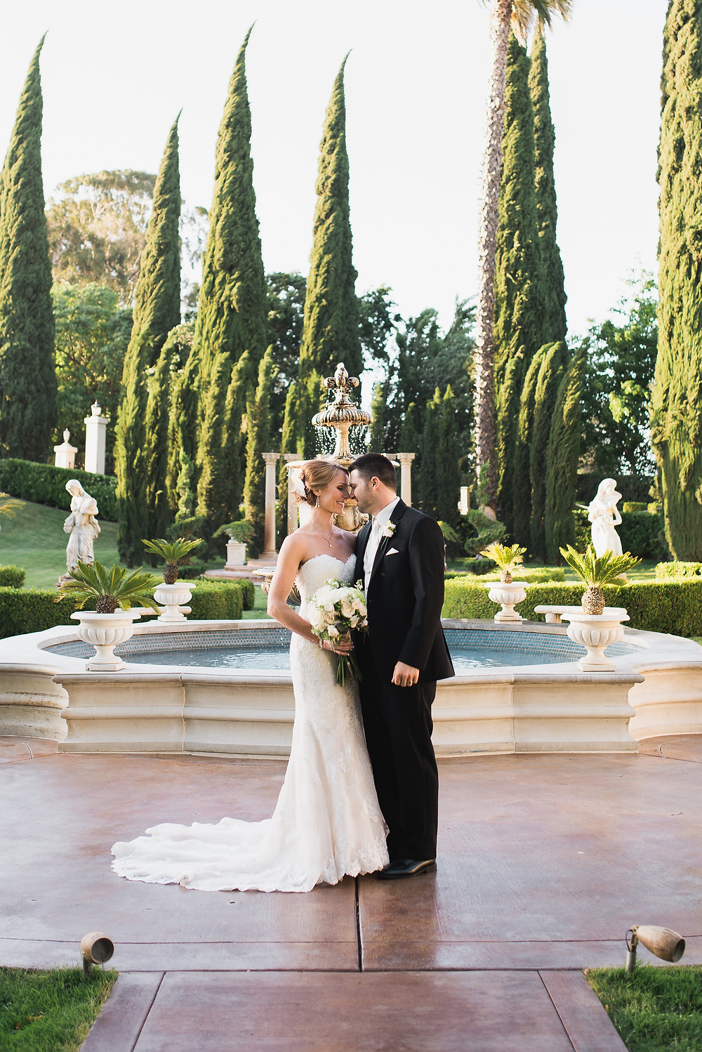 Bride & groom in front of the fountain | Grand Island Mansion | Visual Impact Design wedding flowers | Custock Photography