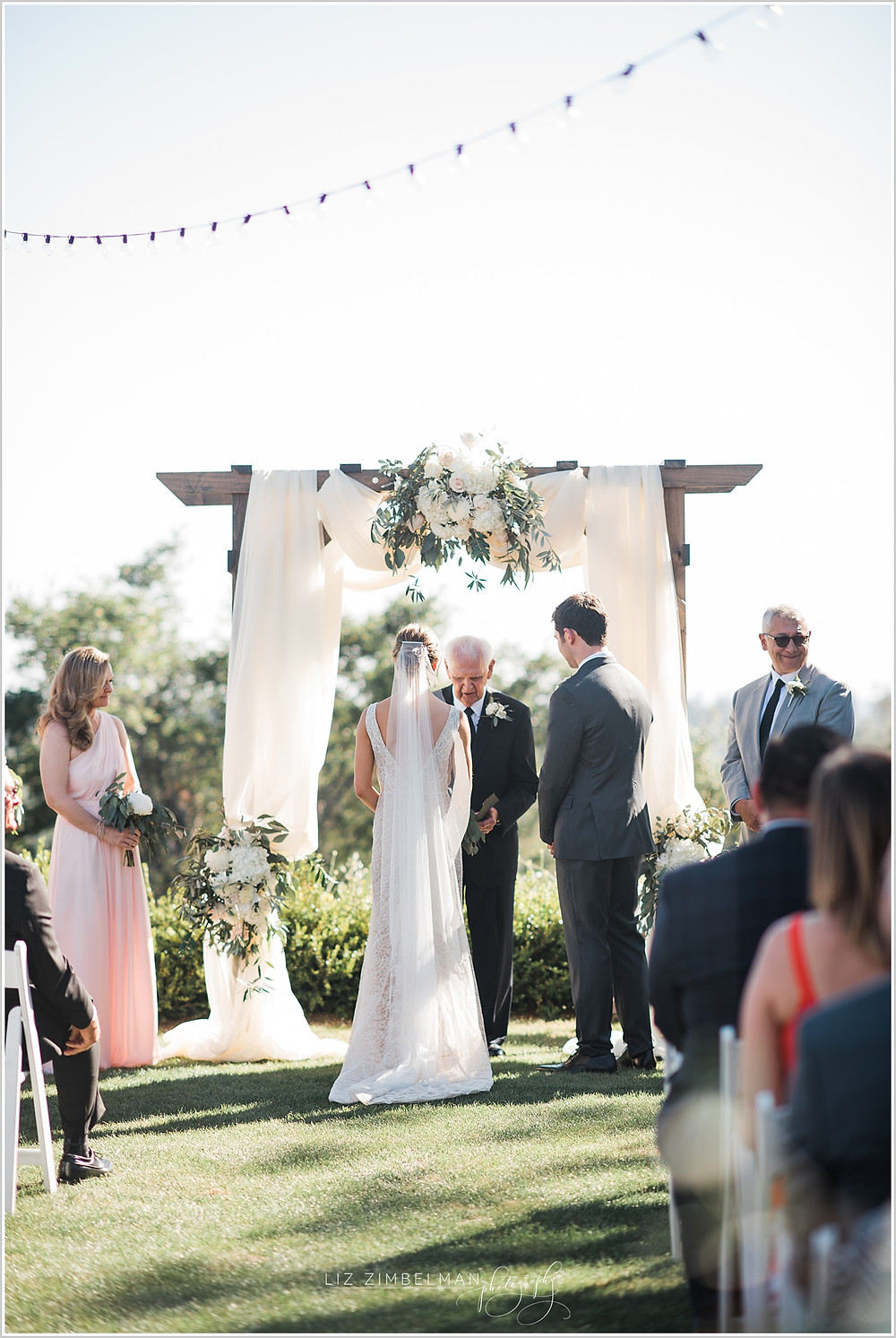 Ceremony altar with wedding arch
