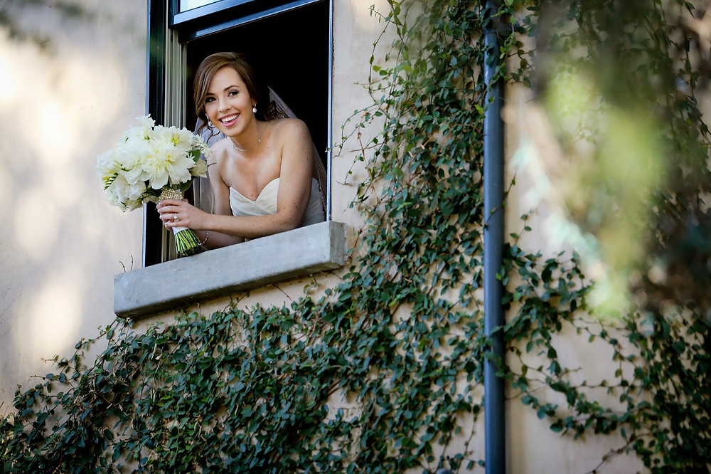 bride hanging out window.jpg
