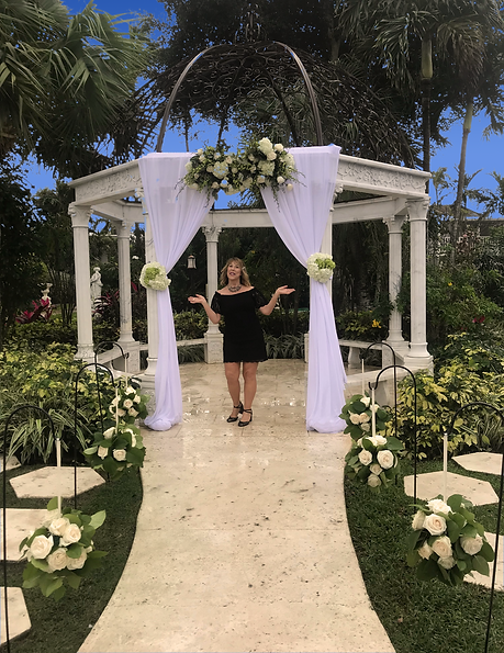 Georgia standing under wedding arbor