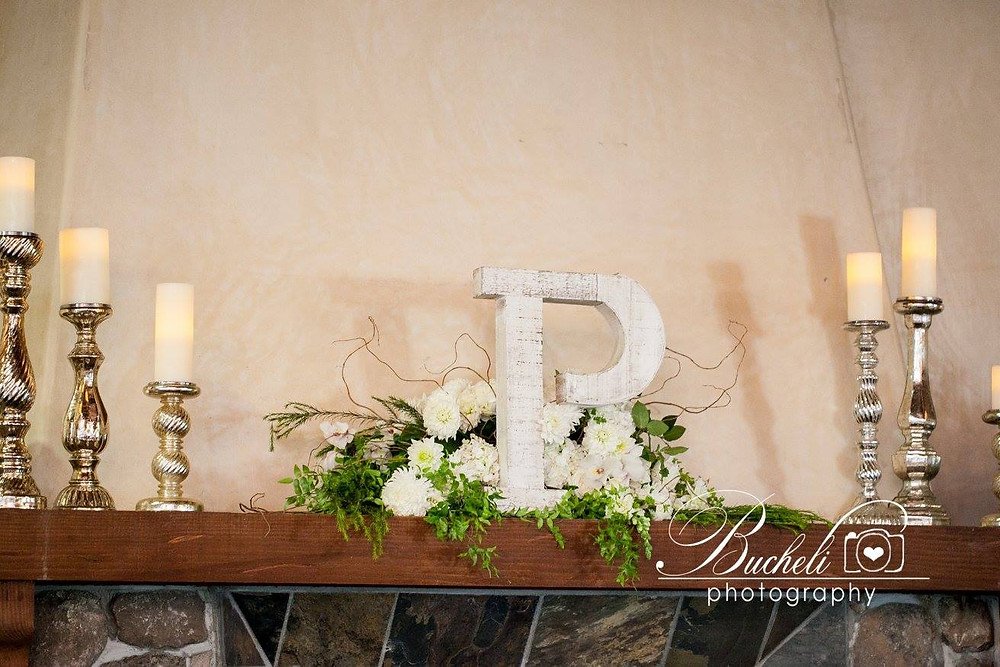Mantel flowers by Visual Impact Design | Bucheli Photography