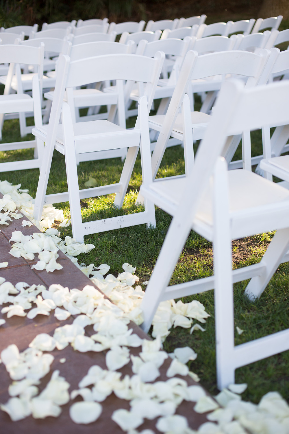 white aisle petals at ceremony