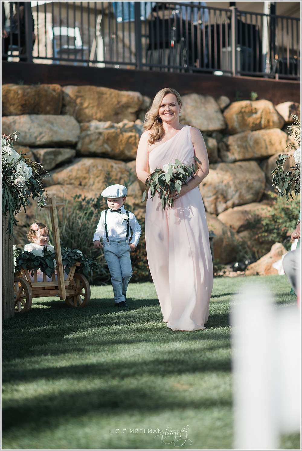 Bridesmaid walking down aisle