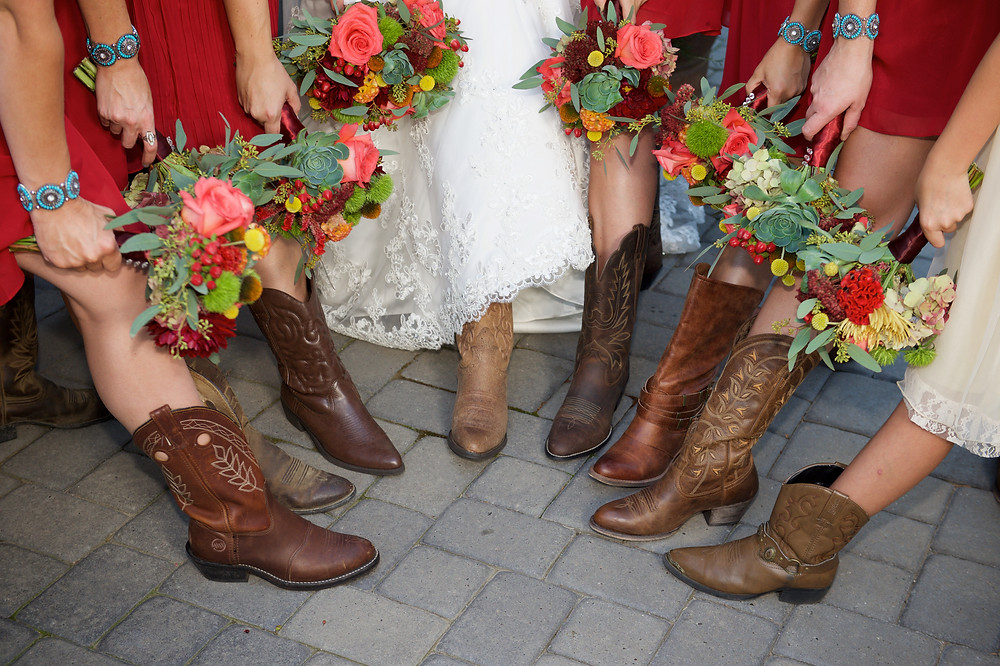 Country barn wedding. Bouquets in wedding colors were an earth tone palette of burgundy, rust, yellow, brown and green by Visual Impact Design. Sharpe Wedding Photography.