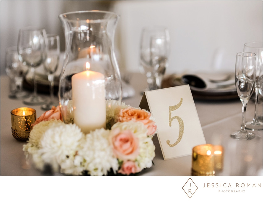 Floral centerpiece & candles by Visual Impact Design | Jessica Roman Photography