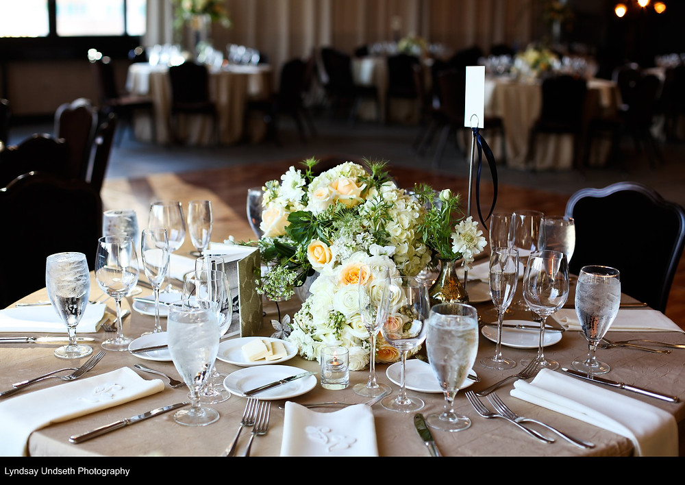 Low floral centerpieces in buttercream, soft apricot, green and white by Visual Impact Design, Sacramento Wedding Florist | Kate Whelan Events | Lyndsay Undseth Photography | Citizen Hotel Wedding Reception