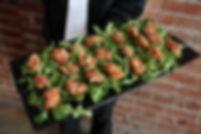 served on herb crostinis on a bed of arugula