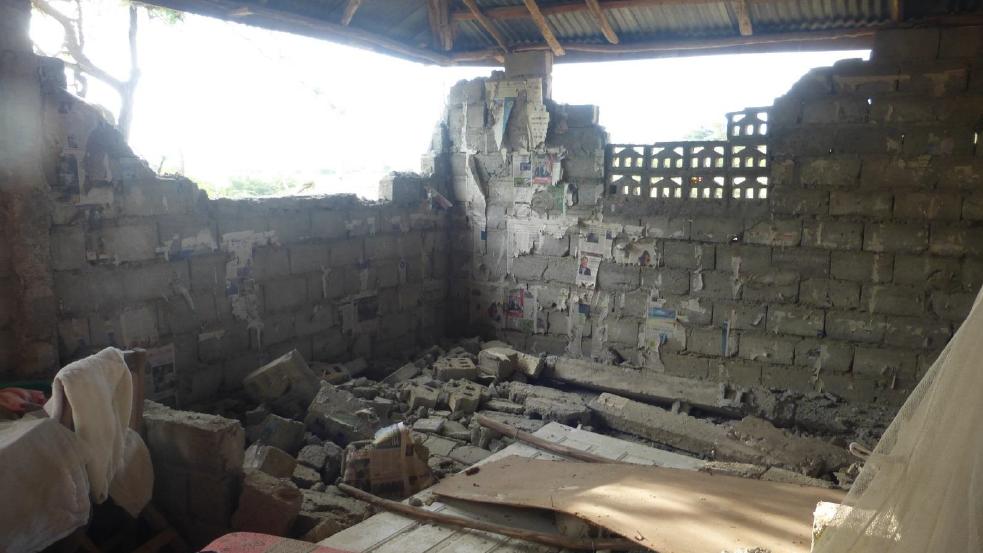 Home damaged by earthquake near Port-de-Paix