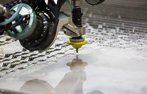 The waterjet cutting CNC machine in work