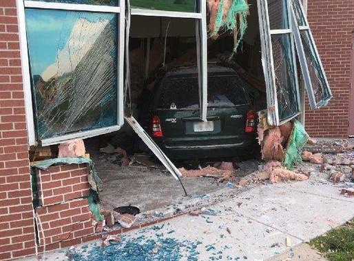NSP investigating minivan crash into weigh station