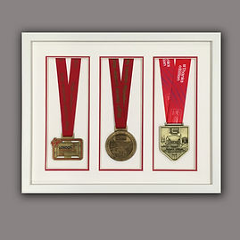 London marathon medals framed by English