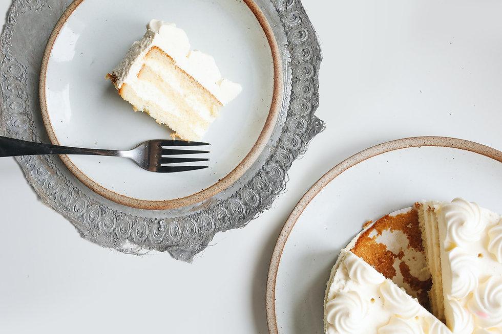 white-and-brown-cake-on-white-ceramic-pl