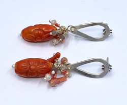carved coral drop ears