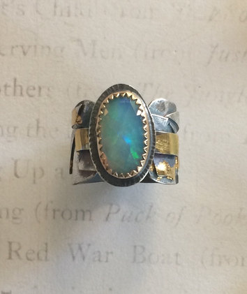 Large AAA Welo Opal held in 14kt gf bezel on a band of raw fused sterling , burnished with 24 kt gold, patina applied