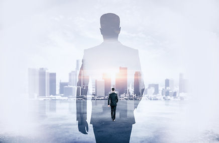 Back view of young businessman walking o