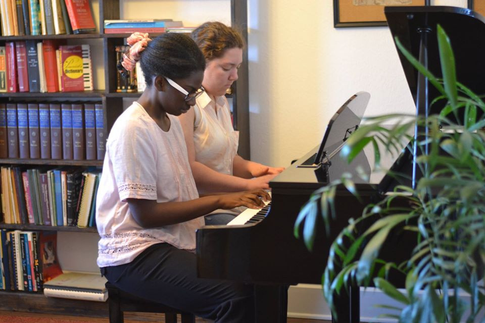 Cecilia and Jordyn piano front room.jpg