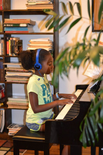 practising at front room piano.jpg