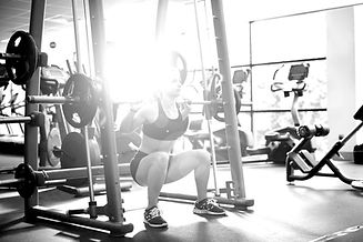 Woman%20Lifting%20Weights_edited.jpg
