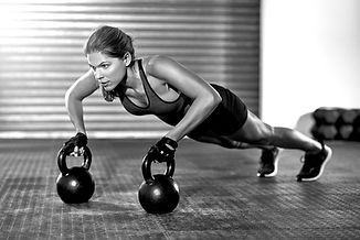 Athletic%20Woman%20With%20Kettlebells_edited.jpg