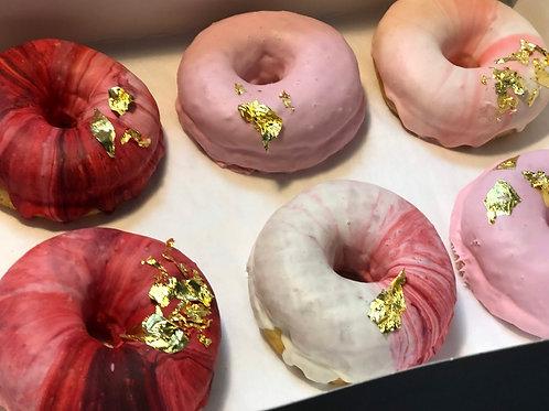 Red marbled white chocolate ganache doughnuts