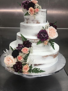 Want to use this as inspiration for your wedding cake? Favorite this cake and show us during your consultation!  For more information, including the frosting and flavors used on this cake, call (856) 853-4747 or visit our storefront!