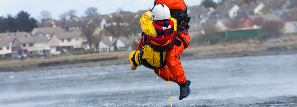 Irish Coast Guard crew display a water r