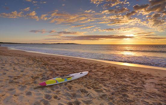 Beach Sunrise And Paddleboard On Shoreline.jpg