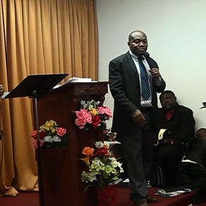 Paster Ezekiel ministering at a church in Montreal, Canda