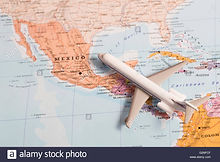 miniature-of-a-passenger-airplane-flying-over-the-map-of-mexico-from-G2NFCF.jpg