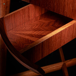 Marquetry pattern inside the drawers.