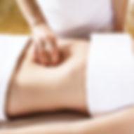 Beautiful young woman having deep abdomina colon massage