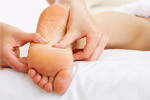 Trigger point therapy on the sole of a foot