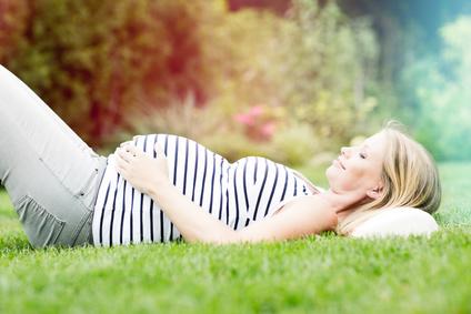 Pregnanct lady resting on grass