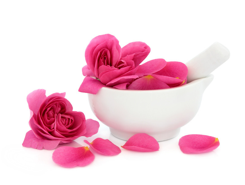 Pink rose petals in a white bowl