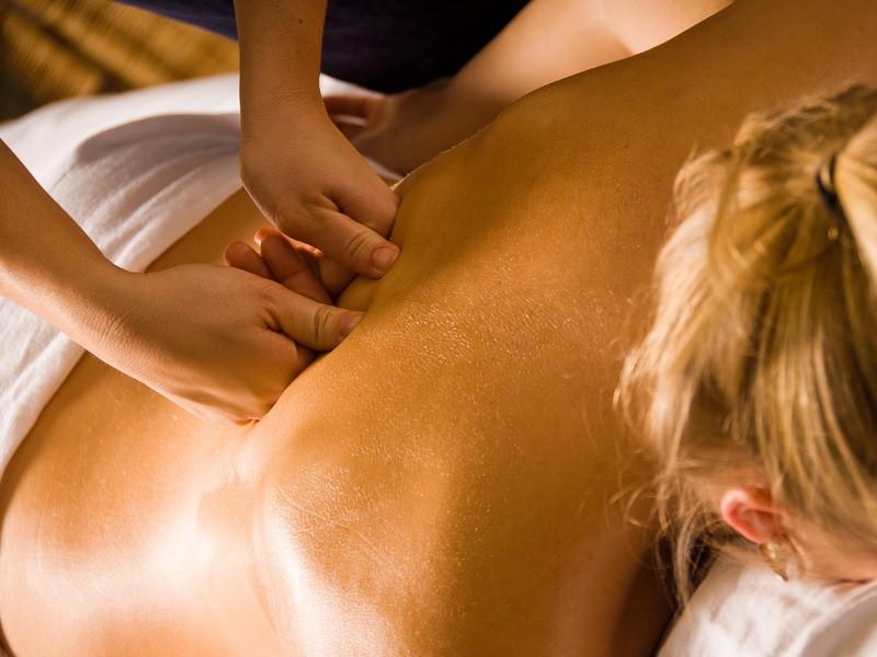 Lady having deep tissue massageon her back