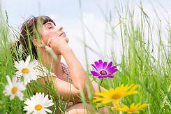 woman relaxing inwild flower garden