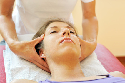 lady having CranioSacral therapy on her head