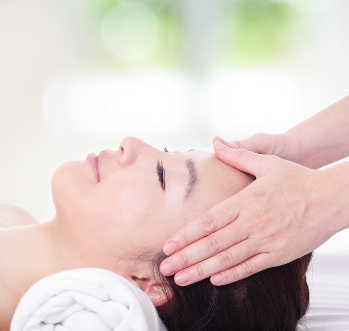 Lady having an indian head massage