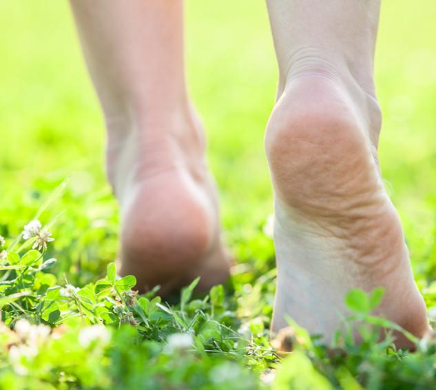 Feet walking on grass