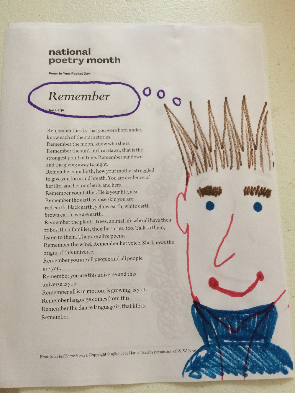 "Printed text of Joy Harjo's poem ""Remember,"" with marker drawing decoration of a figure--as if the figure is thinking the poem into existence"