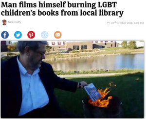 """Dropping the copy of Two Boys Kissing into the fire, he said: """"That one won't be going on the shelf any more!"""""""