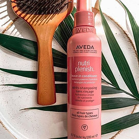 Protect hair from heat styling with detangling, lightweight Nutriplenish Leave-in Conditio
