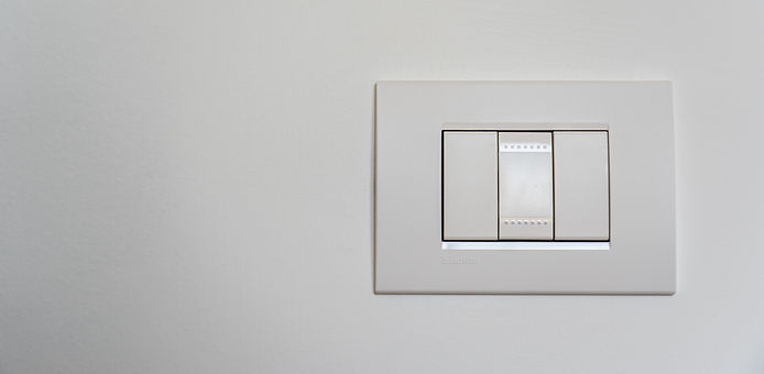 white-light-switch-on-white-painted-wall